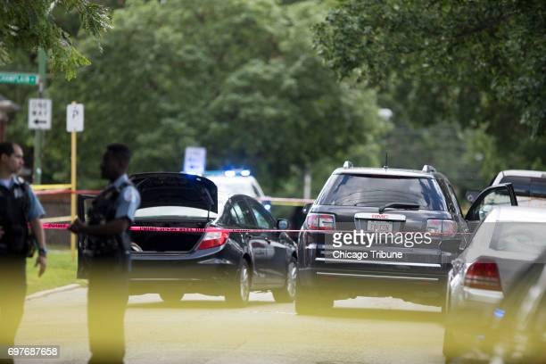 Chicago Police officers investigate the scene of a shooting on the 600 block of East 82nd Street Sunday June 18 in the Chatham neighborhood of...