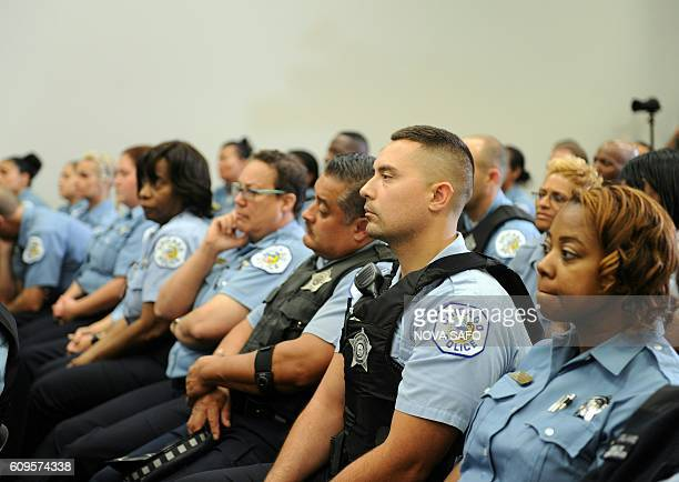 Chicago police officers listen as Chicago Police Department Superintendent Eddie Johnson speaks during a press conference in Chicago on September 21...