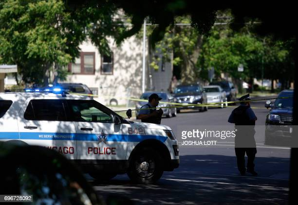 Chicago Police officers stand outside Warren Elementary School where two girls 7 and 13 were shot during a school picnic on June 16 in Chicago...