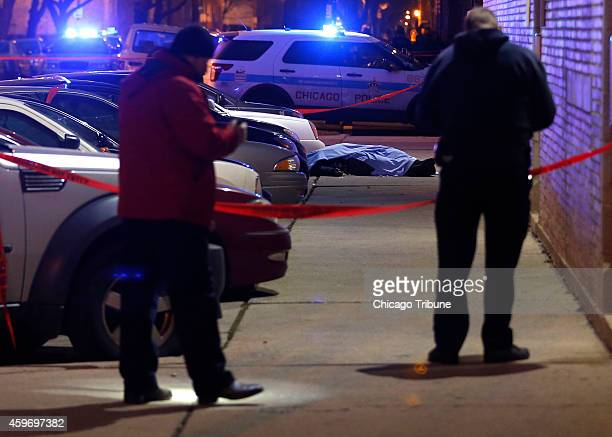 Chicago police secure the scene of a double shooting that left one teen dead and another injured in Chicago on Friday Nov 28 2104