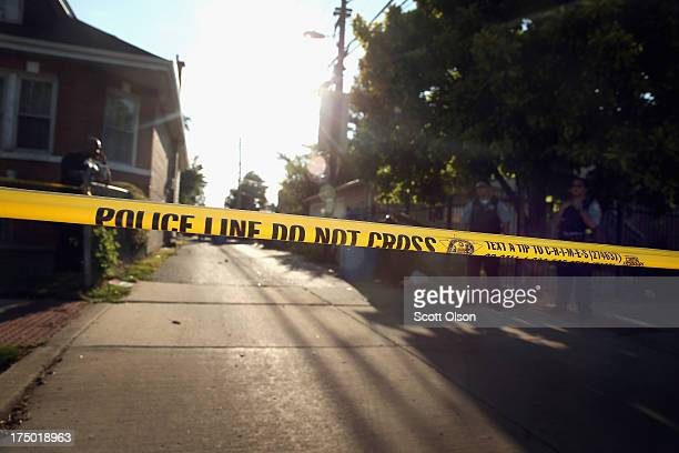 Chicago police secure the scene where two people including Khalise Porter believed to be fouryearsold were shot in the Marquette Park neighborhood on...