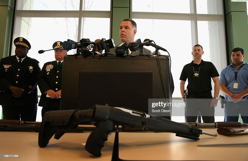 Chicago Police Superintendent Garry McCarthy stands in front of a small display of guns, including a .22 cal. rifle (front), during a press conference in the Englewood neighborhood on May 6, 2013 in Chicago, Illinois. McCarthy said Chicago police confiscate an average of more than 130 illegal guns each week. On Saturday about a mile from the police station where McCarthy spoke, 47-year-old Denise Warfield was found stabbed to death inside as abandoned church building. Less than two blocks from Warfield's murder, three men were shot while walking near the First Mennonite Church of Chicago shortly after midnight Monday morning.