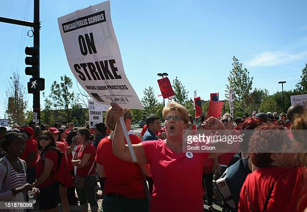 Chicago public school teachers and their supporters picket outside of Marshall High School on September 12 2012 in Chicago Illinois More than 26000...