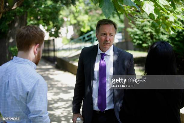 Chicago Public Schools chief executive Forrest Claypool stands outside Warren Elementary School where two girls 7 and 13 were shot during a school...