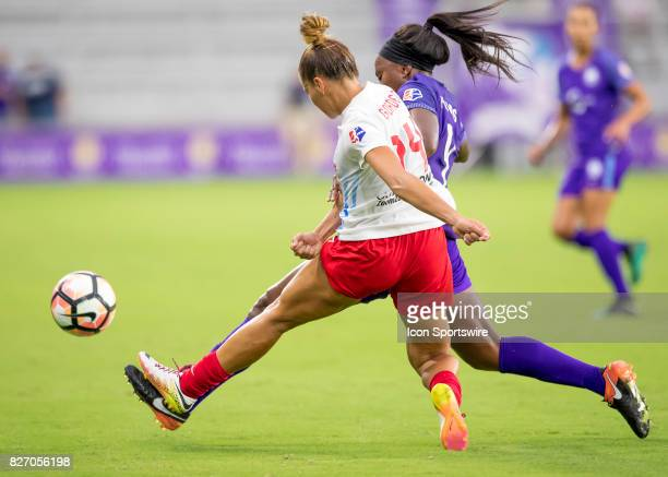 Chicago Red Stars defender Sarah Gorden clears a ball on defense verses Orlando Pride midfielder Jamia Fields during the NWSL soccer match between...