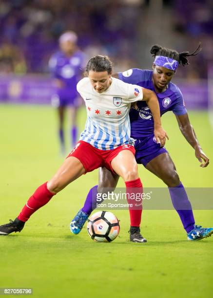 Chicago Red Stars midfielder Taylor Comeau holds possession verses Orlando Pride forward Jasmyne Spencer during the NWSL soccer match between the...