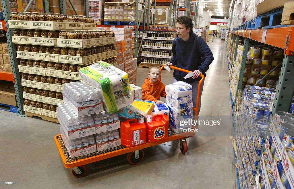 Chicago resident Sharon Szafoni and her 5yearold son Mathew shop in the bulkfoods aisle with a large grocery cart March 8 2002 in a Costco Wholesale...