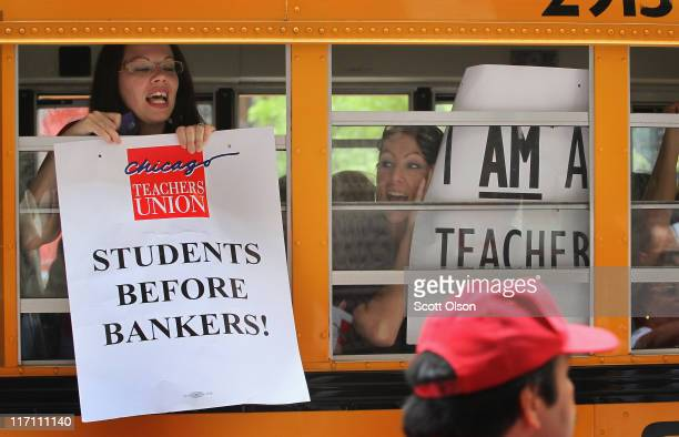 Chicago school teachers display protest signs from inside a school bus as they leave a demonstration outside the Chicago Board of Education building...