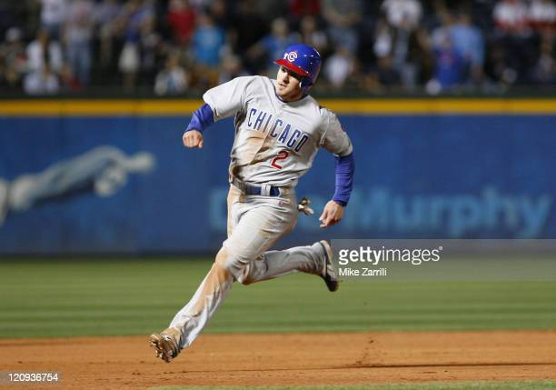Chicago second baseman Ryan Theriot rounds second base during the game between the Atlanta Braves and the Chicago Cubs at Turner Field in Atlanta...