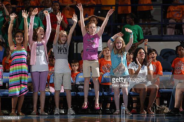 Chicago Sky fans participate in 'the wave' during the WNBA game against the San Antonio Silver Stars on July 14 2010 at the AllState Arena in...