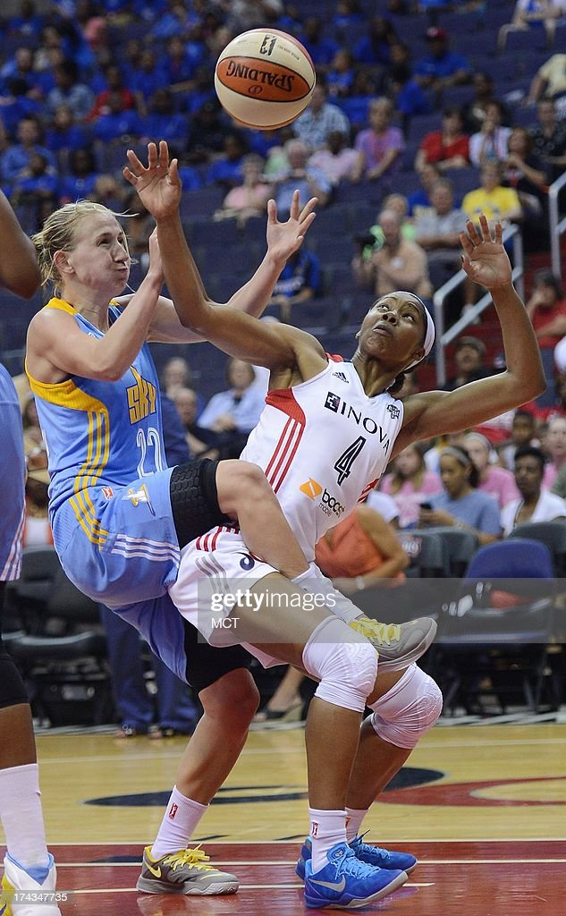 Chicago Sky guard Courtney Vandersloot (22) and Washington Mystics guard Tayler Hill (4) tangle while battling for a rebound in the fourth quarter at the Verizon Center in Washington, D.C., Wednesday, July 24, 2013, The Mystics defeated the Sky, 82-78.
