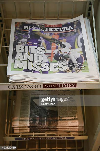 Chicago SunTimes newspapers are offered for sale at a 7Eleven store on December 2 2013 in Chicago Illinois Guild member are expected to vote today on...