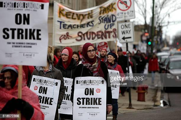 Chicago teachers picket during a oneday strike on April 1 2016 in Chicago Illinois Chicago teachers and the Chicago Teachers Union Local 1 are...