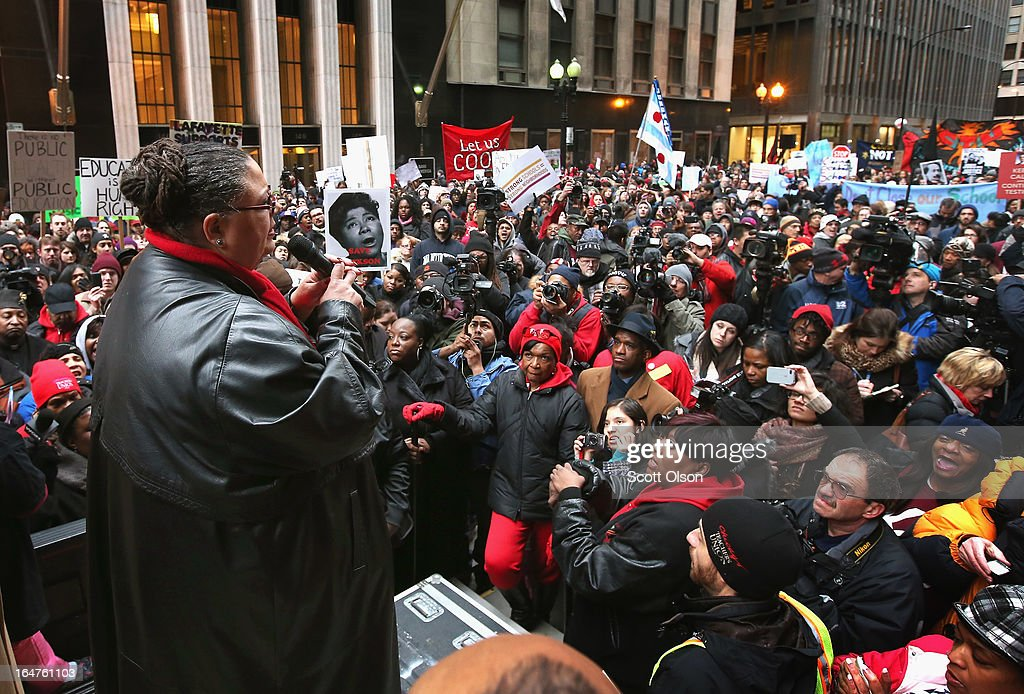 Chicago Teachers Union President Karen Lewis speaks to demonstrators protesting school closings on March 27, 2013 in Chicago, Illinois. About 2,000 protestors held a rally and marched through downtown to protest a plan by the city to close more than 50 elementary schools, claiming it is necessary to rein in a looming $1 billion budget deficit. The closings would shift about 30,000 students to new schools and leave more than 1,000 teachers with uncertain futures.