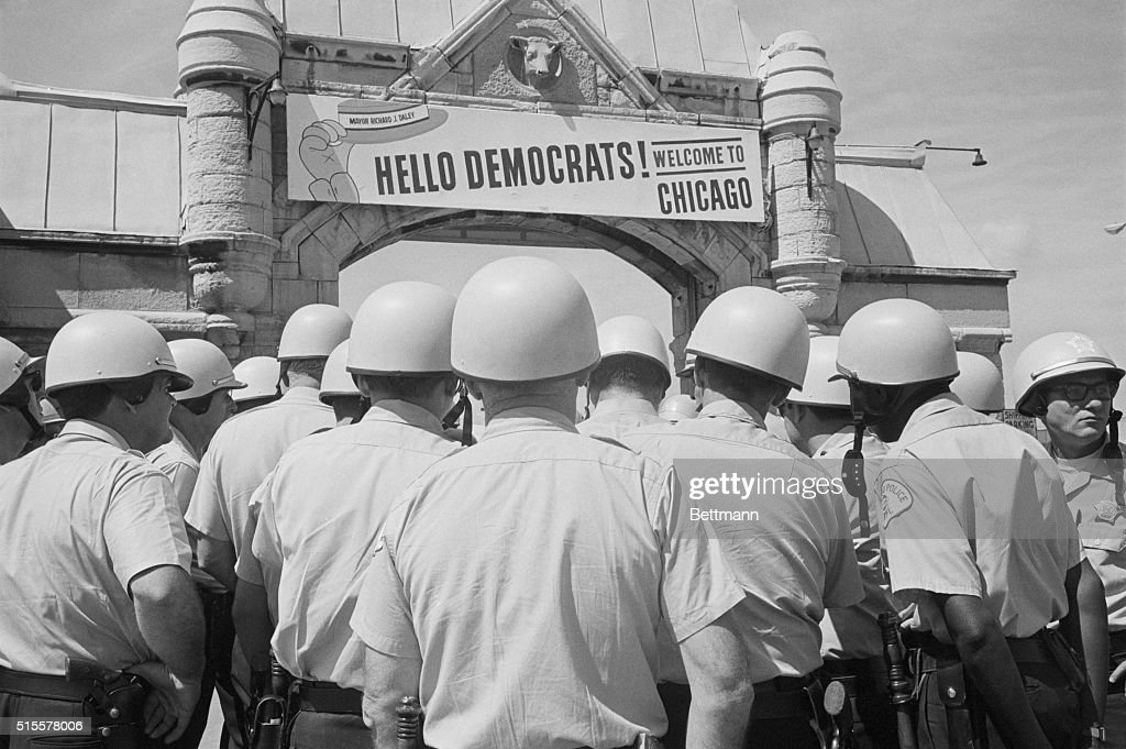 The sign over archway leading to the International Ampithetre welcomes delegates to the Democratic National Convention but from the sea of police...