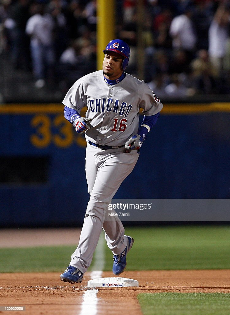 Chicago third baseman Aramis Ramirez rounds third base after hitting a home run during the game between the Atlanta Braves and the Chicago Cubs at...