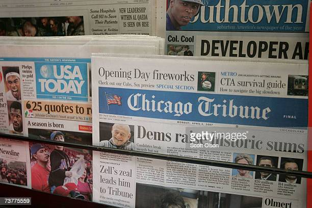 Chicago Tribune newspapers are displayed for sale along with other publications at a kiosk in the downtown Loop area April 2 2007 in Chicago Illinois...