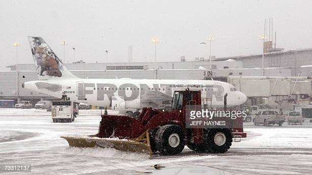 A snow plough clears the ramp area 13 February 2007 at Midway airport in Chicago Over 500 flights have been cancelled at both Chicago airports after...