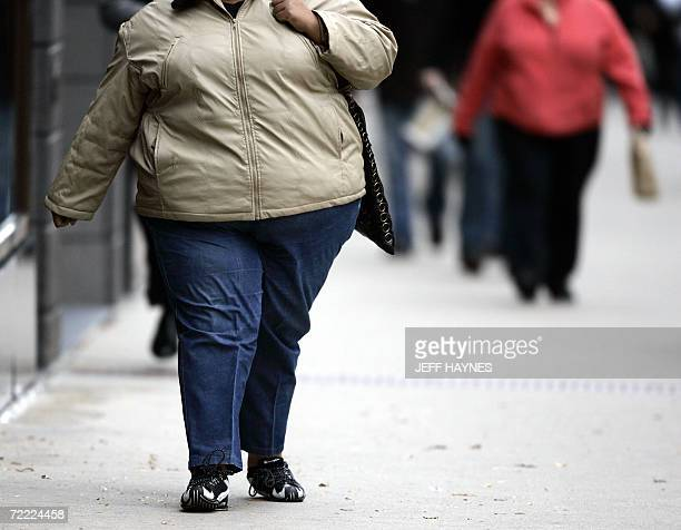 A women walks down the street on Michigan Avenue 19 October 2006 in Chicago Illinois Some 2000 health experts gather in Boston Massachusetts on 20...
