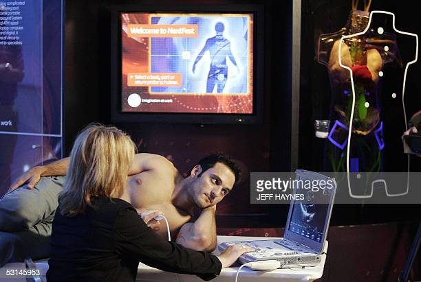 George Horaites has his heart examined by a mobile ultrasound unit during WIRED Magazine's NextFest 24 June 2005 at Navy Pier in Chicago IL NextFest...