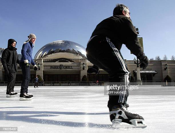 Skaters enjoy a sunny day while skating at the McCormick Tribune Plaza and Ice Rink in Millennium Park 17 January 2007 in Chicago Illinois Cold...