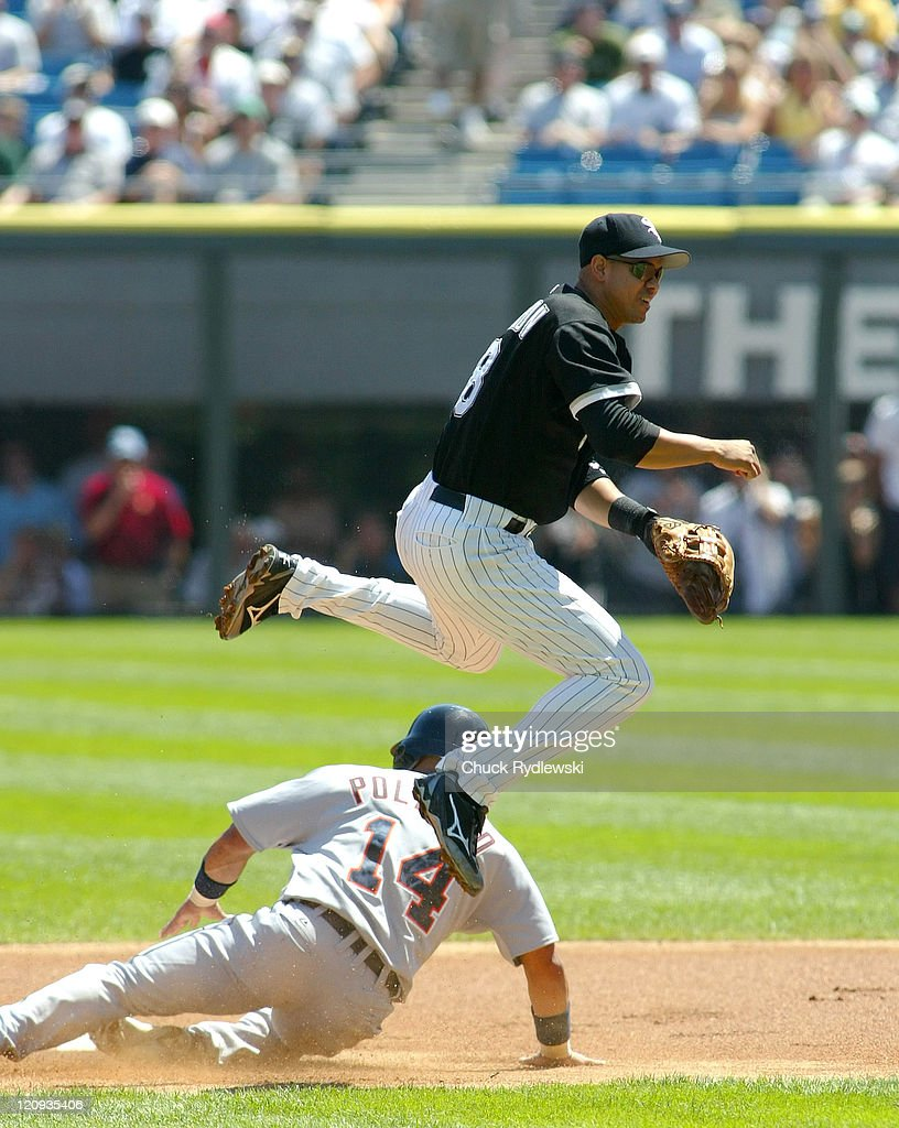 Chicago White Sox' 2nd Baseman Alex Cintron leaps over a sliding Placido Polanco and just misses the batter at first for a double play during their...