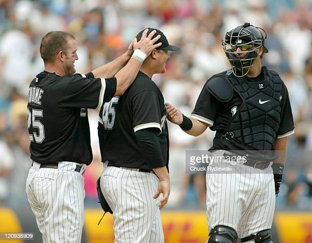 Chicago White Sox' Bobby Jenks Jim Thome and AJ Pierzynski celebrate their sweep of the three game series with the Detroit Tigers August 13 2006 at...