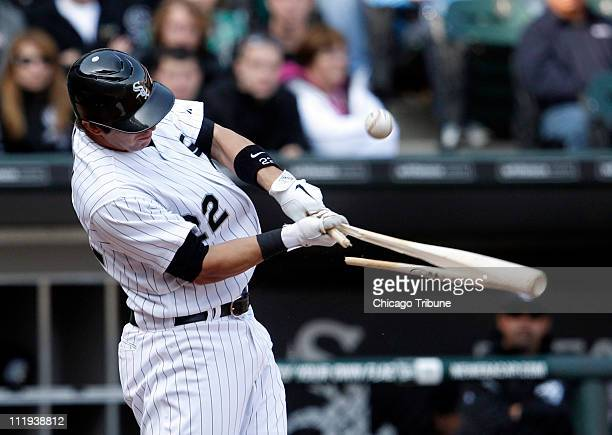 Chicago White Sox' Brent Morel breaks his bat as he gets an RBI singe that scores teammate Paul Konerko during the fourth inning against the Tampa...