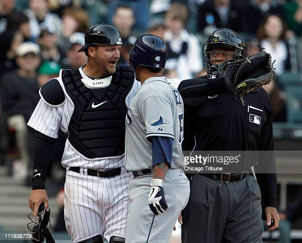 Chicago White Sox catcher AJ Pierzynski left has words with Tampa Bay Rays' Felipe Lopez after Lopez' solo home run during the ninth inning at US...