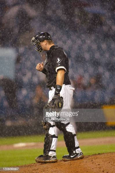 Chicago White Sox' Catcher AJ Pierzynski waits for Manager Ozzie Guillen to change pitchers in a driving rain during their 125 loss to the the Los...