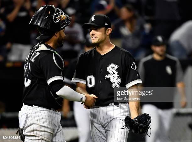 Chicago White Sox catcher Omar Narvaez and Chicago White Sox relief pitcher David Robertson shake hands after defeating the New York Yankees 4 to 3...