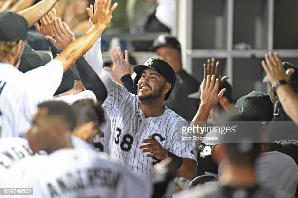 Chicago White Sox catcher Omar Narvaez celebrates with teammates in the dugout after scoring during a game between the Houston Astros and the Chicago...