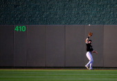 Chicago White Sox center fielder Adam Eaton catches a fly ball during the game against the Kansas City Royals at Kauffman Stadium on May 20 2014 in...