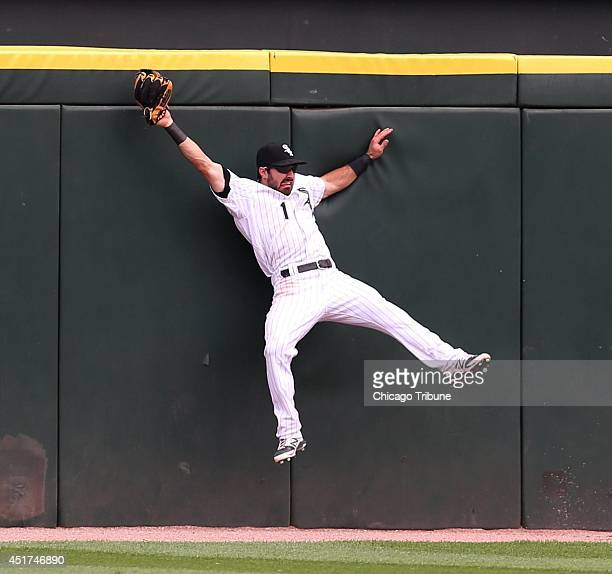 Chicago White Sox center fielder Adam Eaton makes a catch on a long fly ball hit by the Seattle Mariners' Logan Morrison in the 11th inning at US...