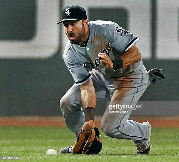 Chicago White Sox center fielder Adam Eaton tried to short hop a bottom of the fifth inning line drive by the Red Sox Brock Holt the ball got by him...