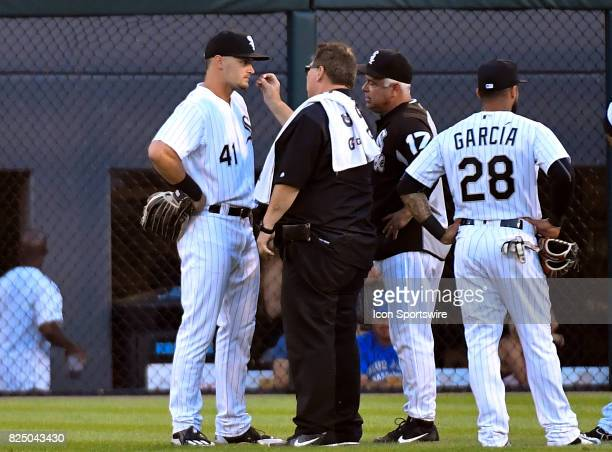Chicago White Sox center fielder Adam Engel is examined by medical staff during the game between the Toronto Blue Jays and the Chicago White Sox on...