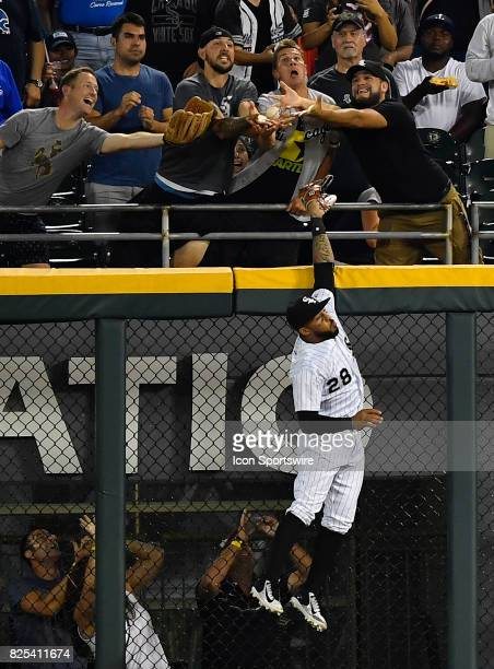 Chicago White Sox center fielder Leury Garcia trying to catch the home run ball hit by Toronto Blue Jays first baseman Justin Smoak during the game...