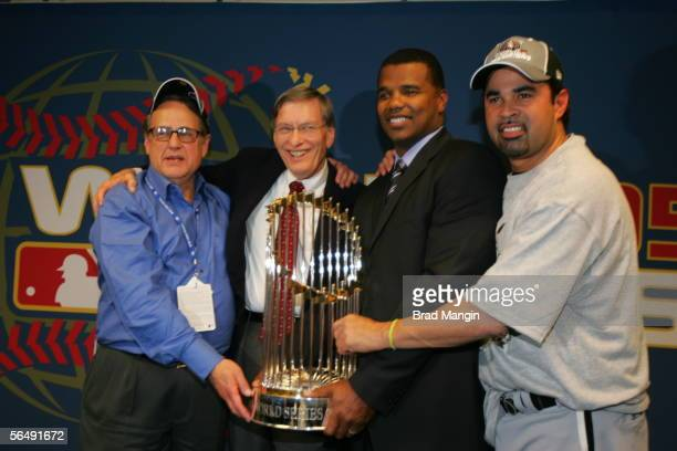 Chicago White Sox chairman Jerry Reinsdorf is presented with the World Series trophy after his team defeated the Houston Astros at Minute Maid Park...