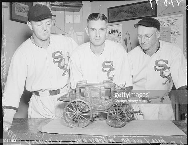 Chicago White Sox coaches Billy Webb Muddy Ruel and Jimmy Austin standing with a model of a stagecoach Chicago Illinois circa 1935 From the Chicago...
