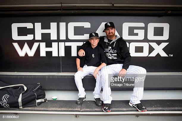 Chicago White Sox designated hitter Adam LaRoche sits with his son Drake in the White Sox dugout at US Cellular Field before a game against the...