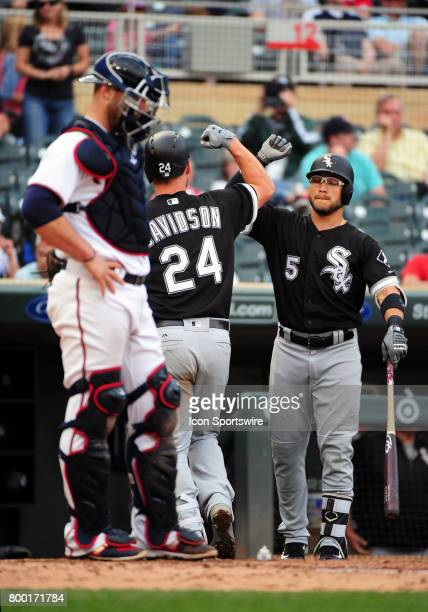 Chicago White Sox Designated hitter Matt Davidson celebrates his solo home run with Chicago White Sox Infield Yolmer Sanchez during a MLB game...