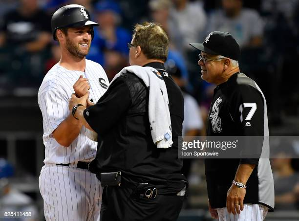 Chicago White Sox designated hitter Matt Davidson is examined by medical staff after being hit by the ball during the game between the Toronto Blue...