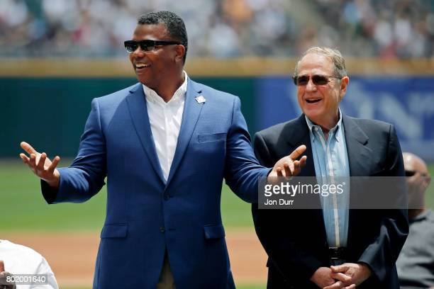 Chicago White Sox Executive Vice President Ken Williams and Chairman Jerry Reinsdorf react as they are introduced before the ceremony to retire the...