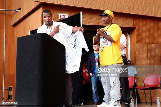 Chicago White Sox Executive VicePresident Kenny Williams presents Jackie Robinson West little league manager Darold Smith with an autographed White...