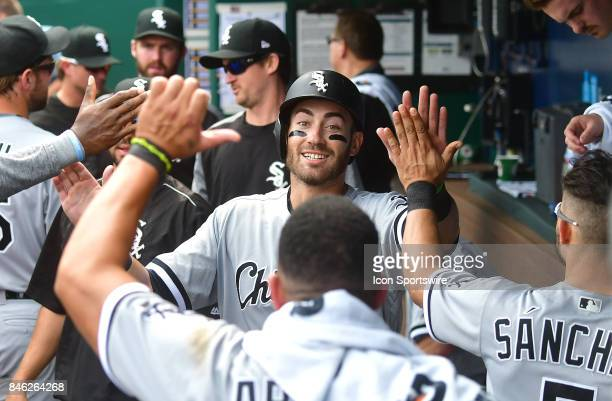 Chicago White Sox first baseman Nicky Delmonico is congratulated by teammates in the dugout after scoring in the fourth inning during a Major League...