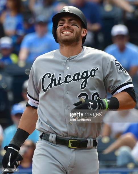 Chicago White Sox first baseman Nicky Delmonico reacts after being hit by a pitch in the second inning during a Major League baseball game between...