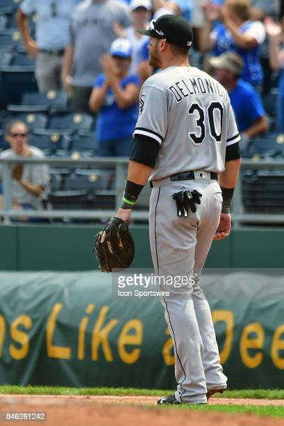 Chicago White Sox first baseman Nicky Delmonico reacts as Royals designated hitter Brandon Moss runs the bases after hitting a grand slam home run...