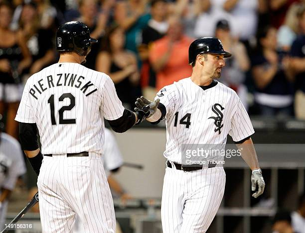 Chicago White Sox first baseman Paul Konerko with Chicago White Sox catcher AJ Pierzynski after Konerko scored on a tworun homer by Chicago White Sox...