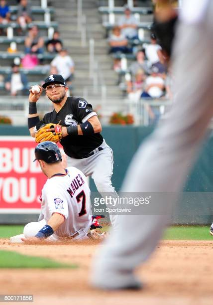 Chicago White Sox Infield Yolmer Sanchez throws the ball over a sliding Minnesota Twins First base Joe Mauer during a MLB game between the Minnesota...