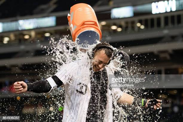 Chicago White Sox left fielder Nicky Delmonico is given an ice bath after hitting a walk off two run home run during the game between the Los Angeles...